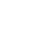 magnifying glass showing a dollar sign over a paper